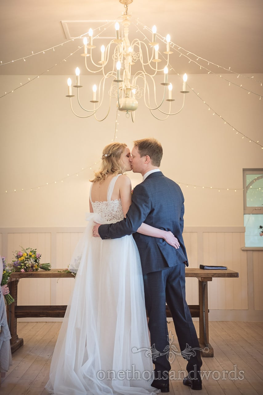 First Kiss Wedding Photograph at Kings Arms Pavilion Wedding Venue in Christchurch Dorset