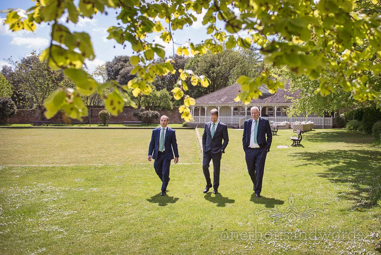 Grooms Party Walk Outside Kings Arms Pavilion on Wedding Morning in Dorset