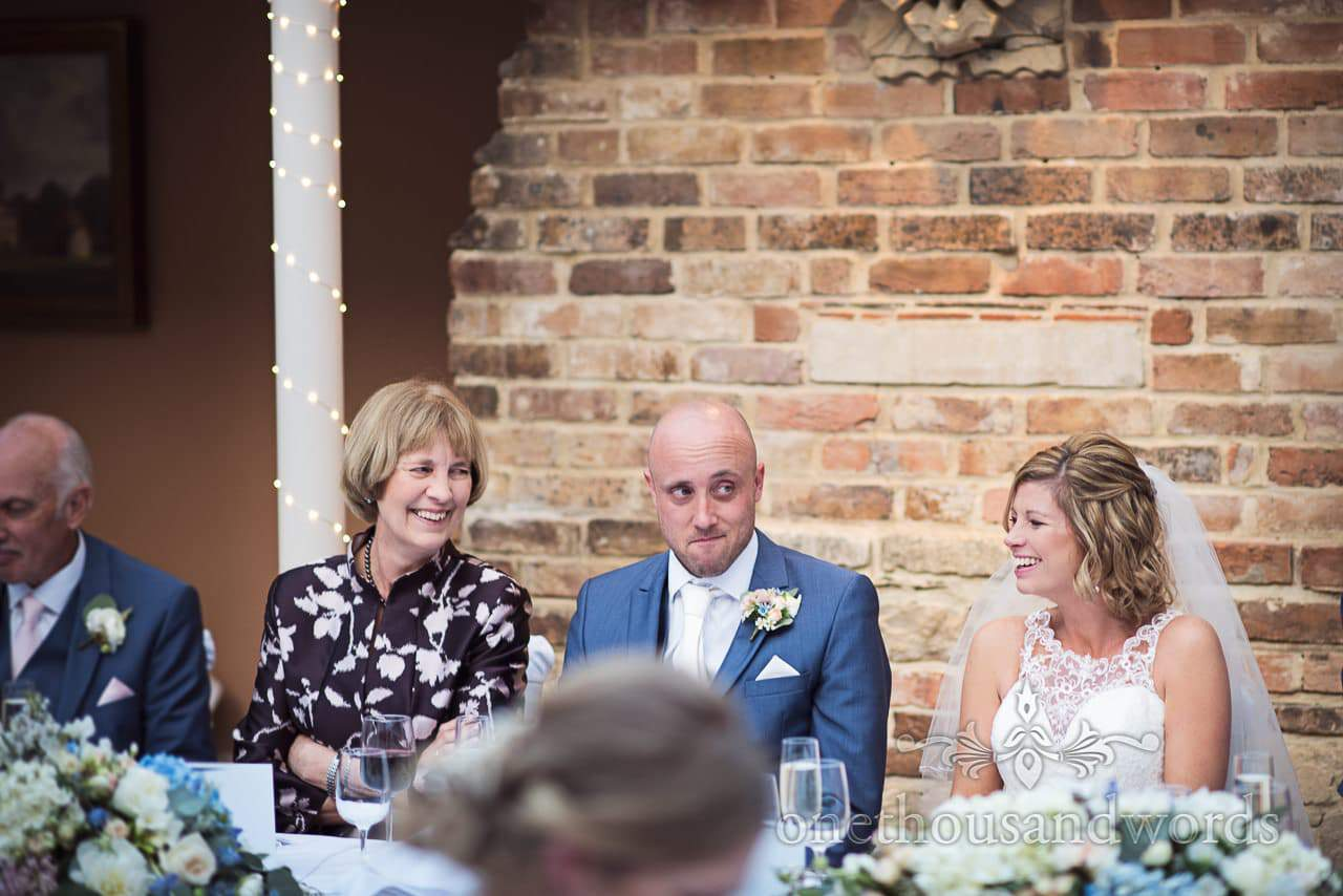 Groom makes naughty face during wedding speeches at Athelhampton House