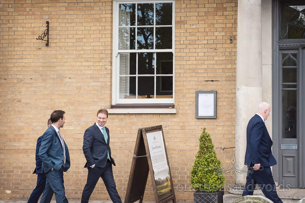 Grooms Party in blue wedding suits Walks to Kings Arms Wedding Venue in Christchurch Dorset