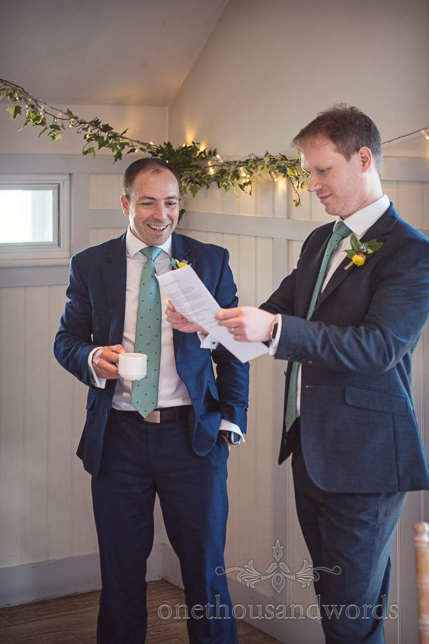Groom Practices His Wedding Speech With Best Man at Kings Arms Hotel Wedding Venue in Christchurch