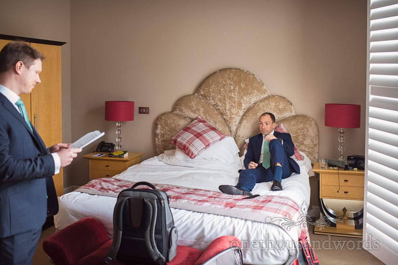 Groom Reads Wedding Speech To Best Man On Bed At Kings Arms Wedding Venue Hotel In Christchurch