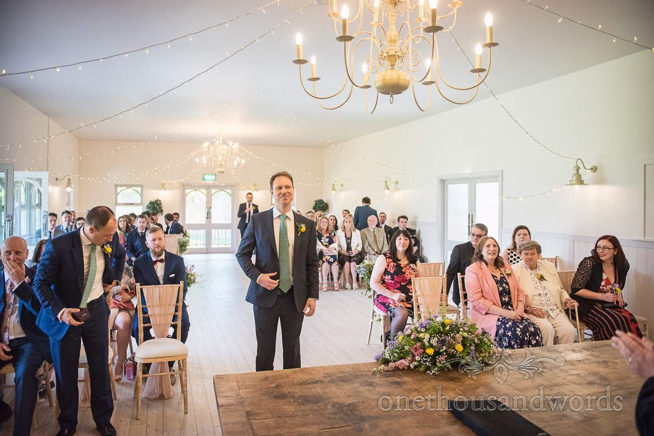 Documentary wedding photograph Groom Waits Bridal Arrival At Kings Arms Pavilion Wedding in Christchurch Dorset