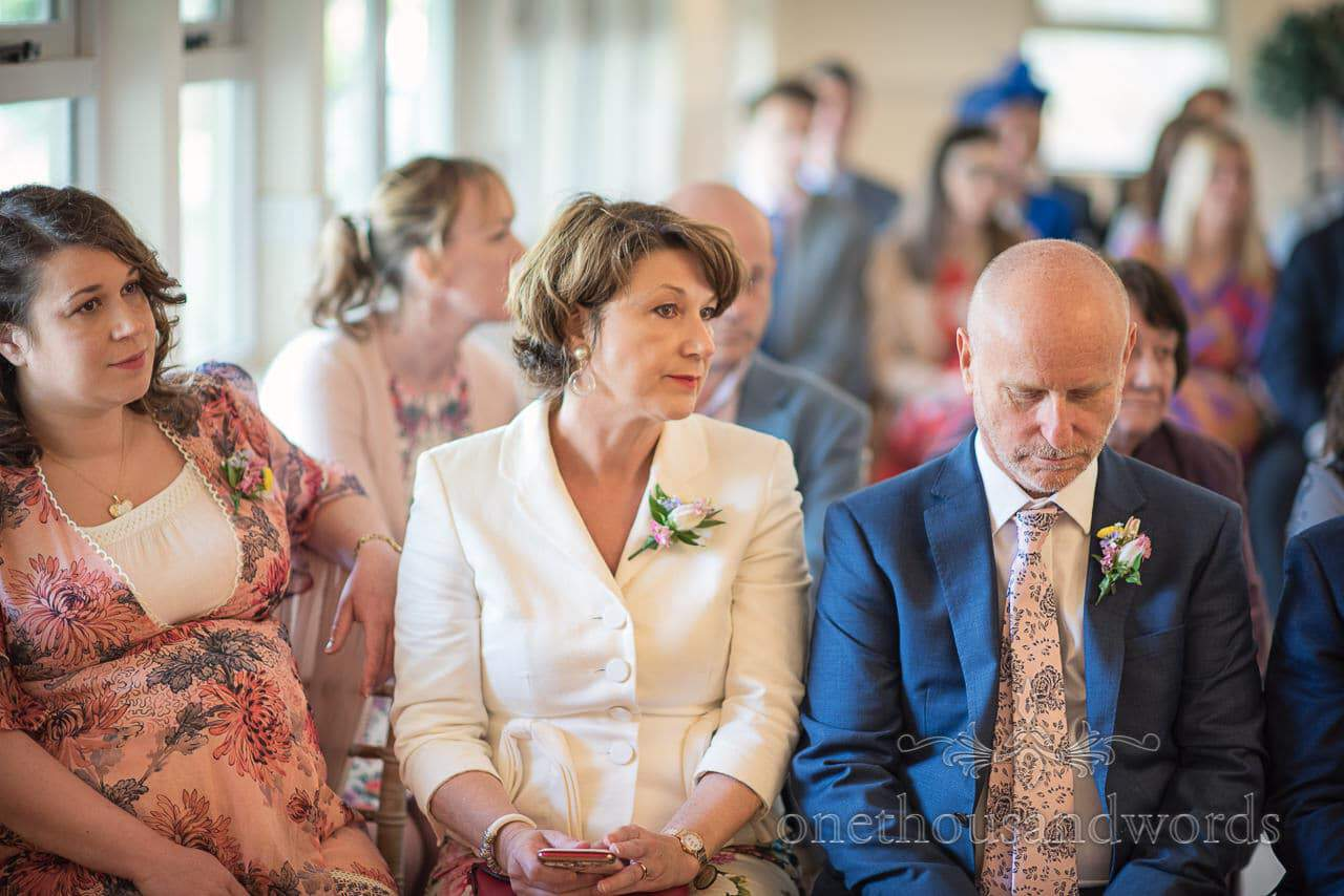 Grooms Family Watch Kings Arms Pavilion Wedding Ceremony in Christchurch, Dorset by one thousand words wedding photography