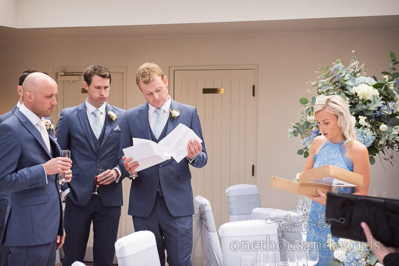 Grooms party check wedding schedule at Athelhampton House