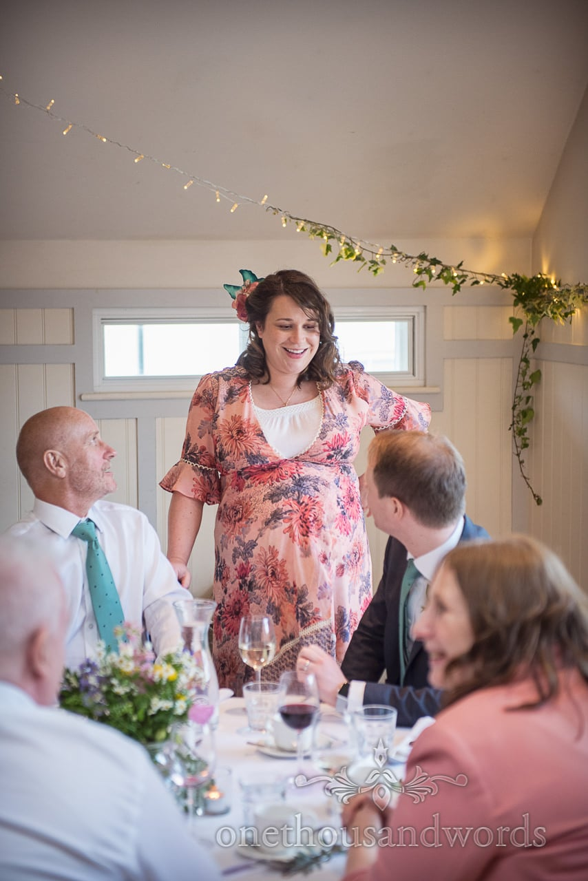 Grooms Sister Floral Pregnancy Wedding Dress Smiling at Wedding Breakfast in Kings Arms Wedding Venue