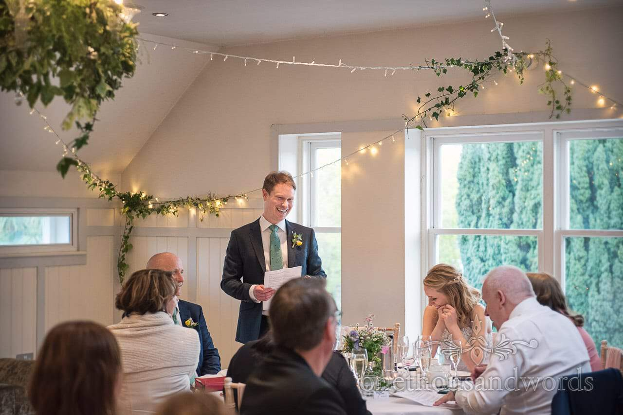 Laughing Grooms Wedding Speech at Kings Arms Hotel Wedding Venue with ivy and fairy light decorations