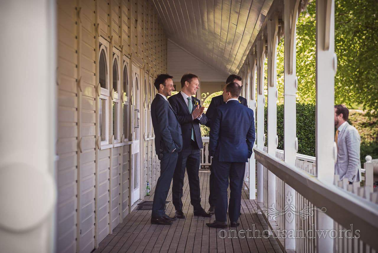 Groomsmen in Blue Wedding Suits waiting on Kings Arms Pavilion Wooden Balcony