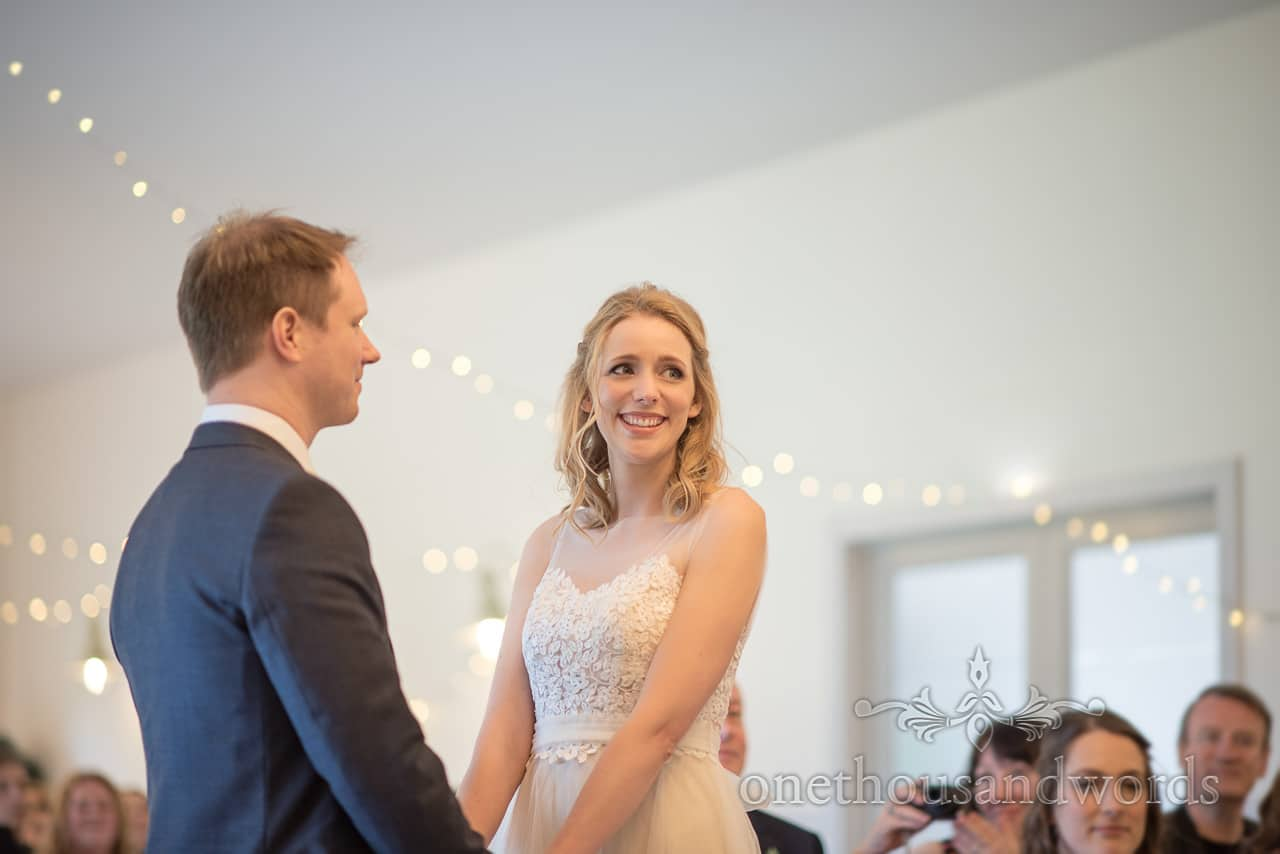 Documentary Wedding Photograph of Happy Bride Smiling During Kings Arms Hotel Pavilion Wedding Ceremony