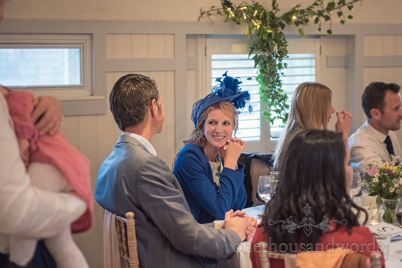 Happy Wedding Guest in blue wedding suit and blue wedding hat with feathers photo at Kings Arms Hotel
