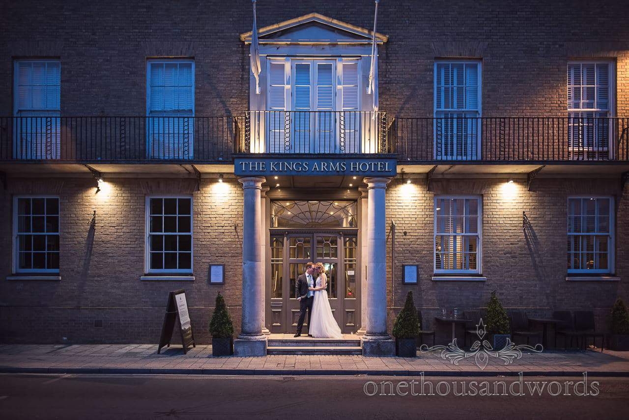 Kings Arms Christchurch Wedding Venue Photograph With Bride Groom at Night by one thousand words wedding photography