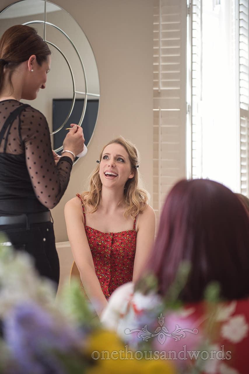 Laughing Bride During Wedding Makeup Bridal Morning Preparations at Kings Arms Hotel Christchurch