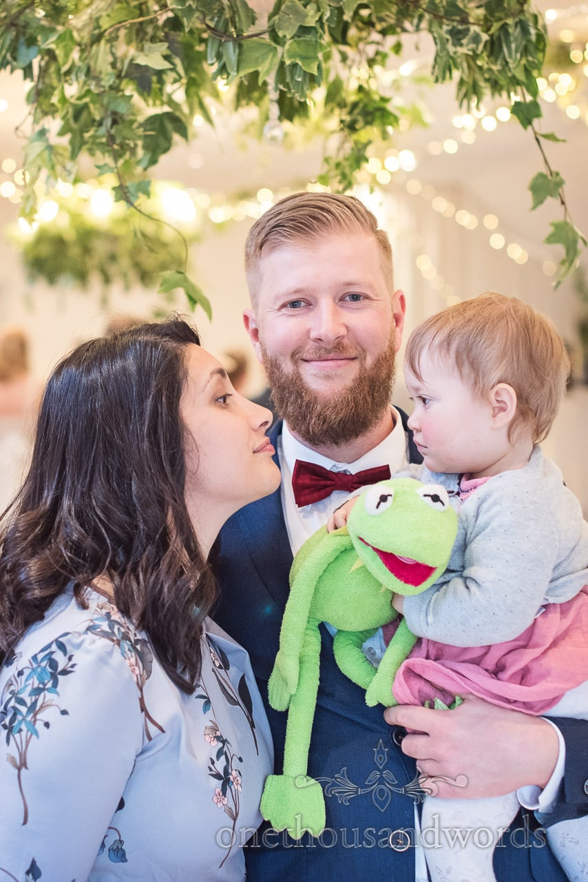 Loving Family Portrait Wedding Photograph Kermit Toy with ivy and fairy lights at Kings Arms Wedding Christchurch