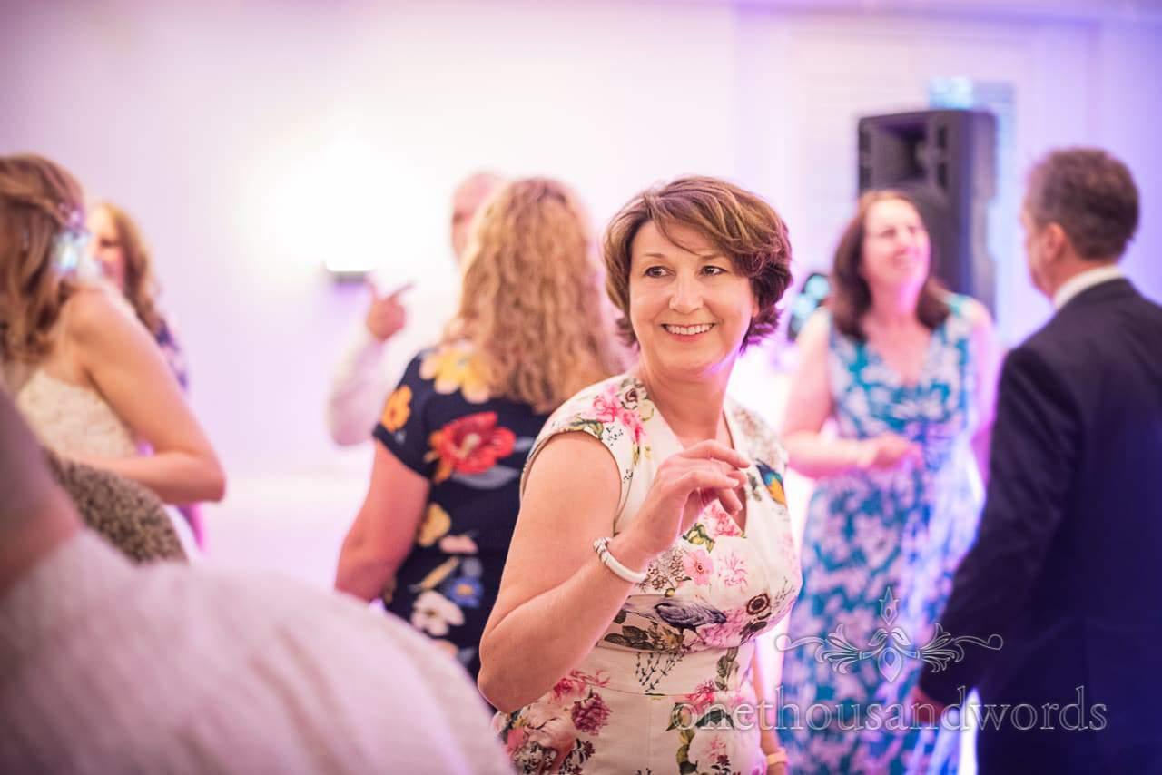 Mother of Groom Dancing to DJ Music Kings Arms Hotel Evening Reception Photographs by one thousand words wedding photography