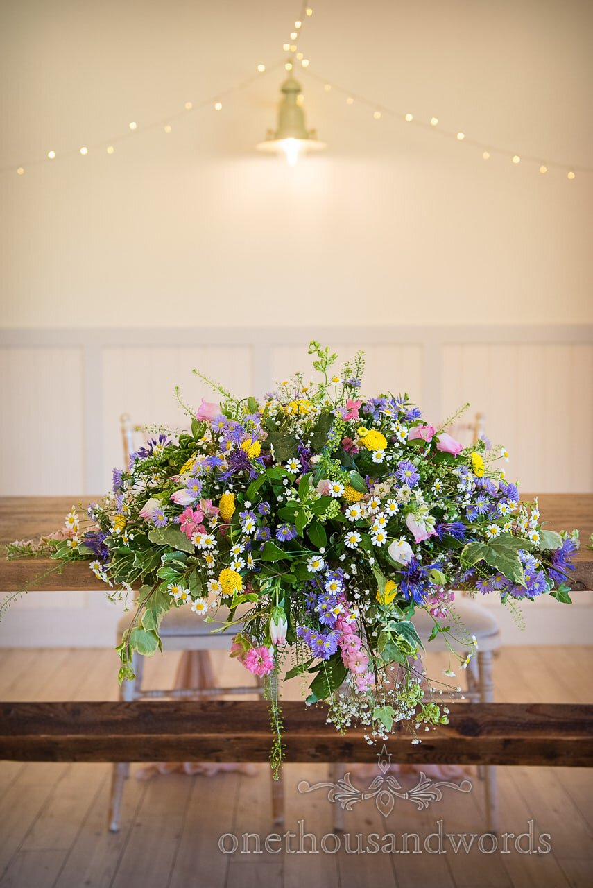 Multi Coloured Wedding Flowers Spring Floral Spray Photograph at Kings Arms Wedding Venue Pavilion in Christchurch