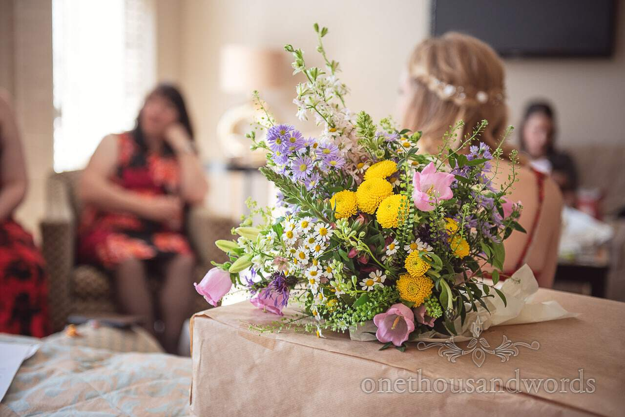Multicoloured Spring Wedding Flower Bouquet During Bridal Morning Preparations Photographs at Kings Arms Hotel