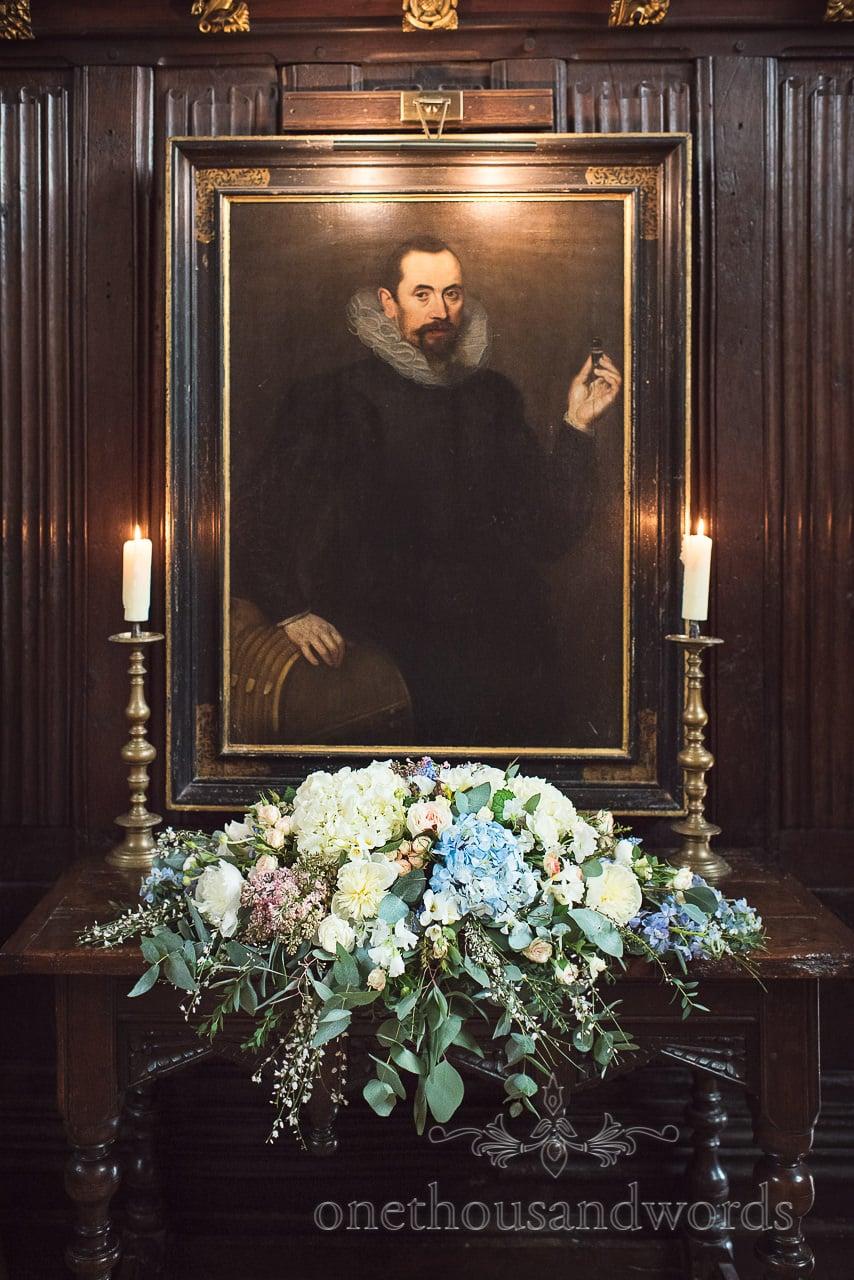 Pastel wedding flower spray with historic painting at Athelhampton House Wedding