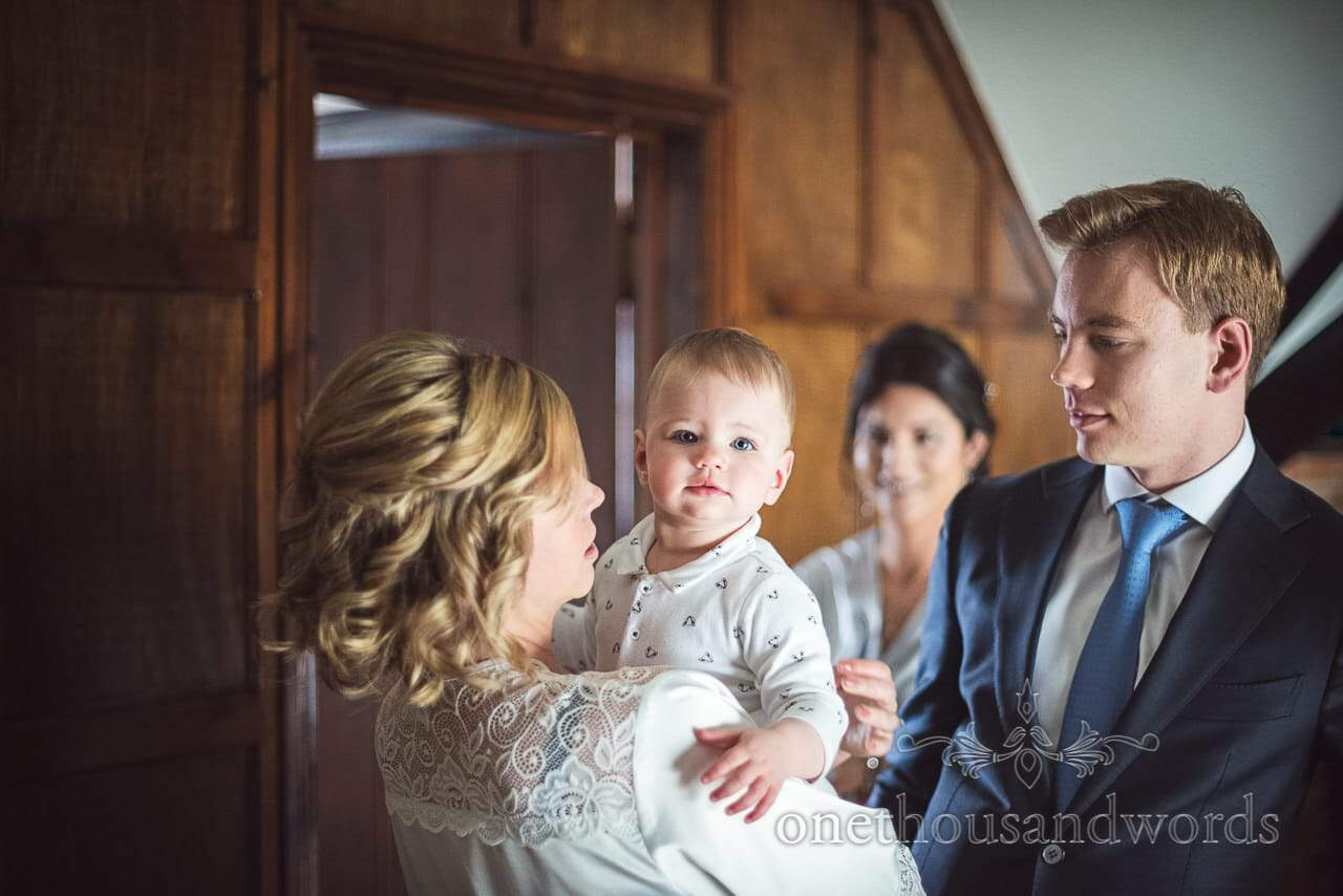 Toddler flower girl portrait photograph with father on wedding morning