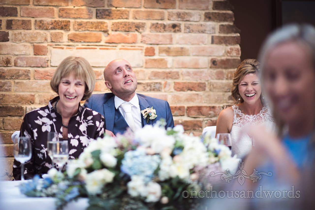 Top table at Athelhampton House Wedding laughing at wedding speeches