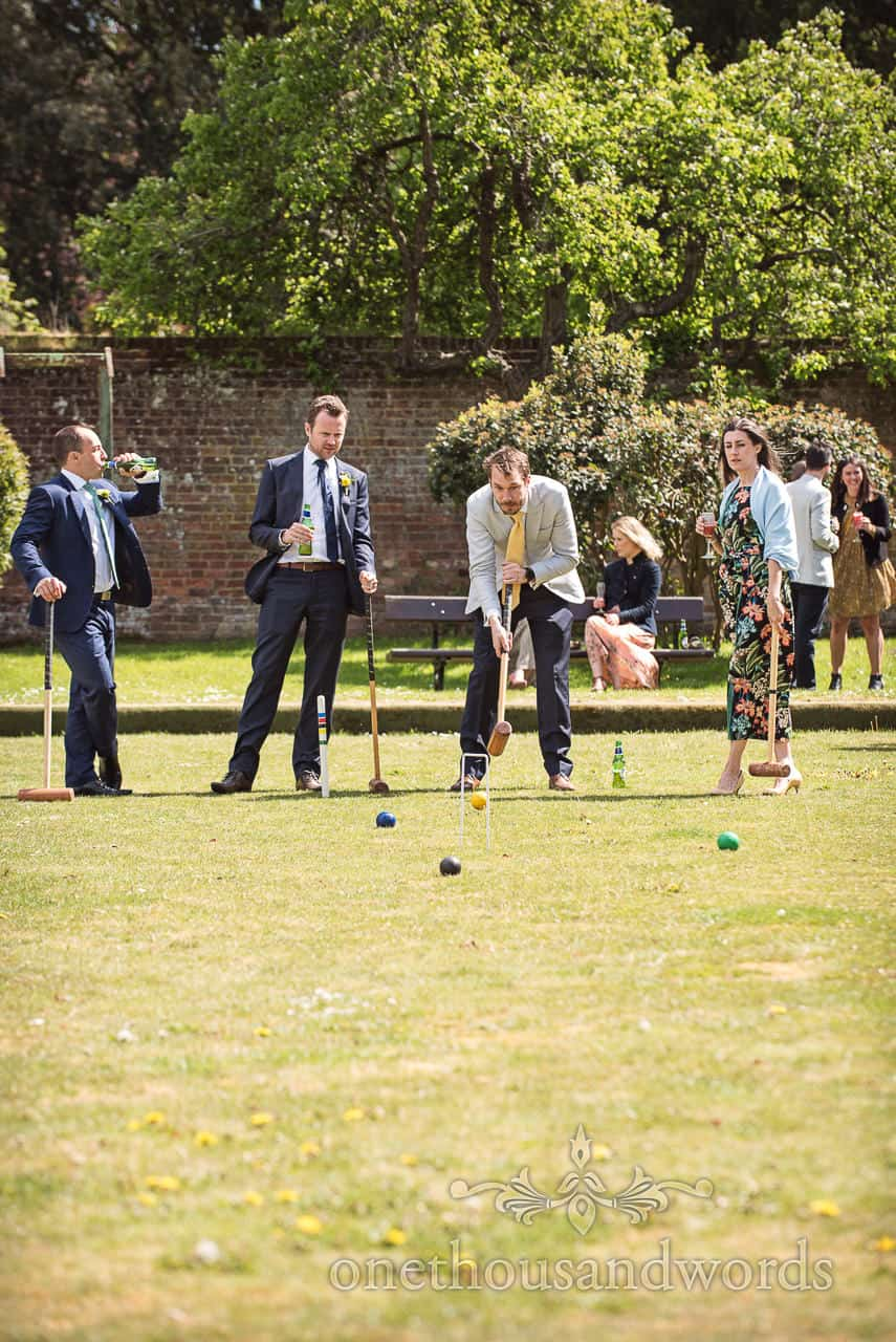 Wedding Drinks Reception Croquet Game on Lawns at Kings Arms Pavilion Wedding by one thousand words wedding photographers