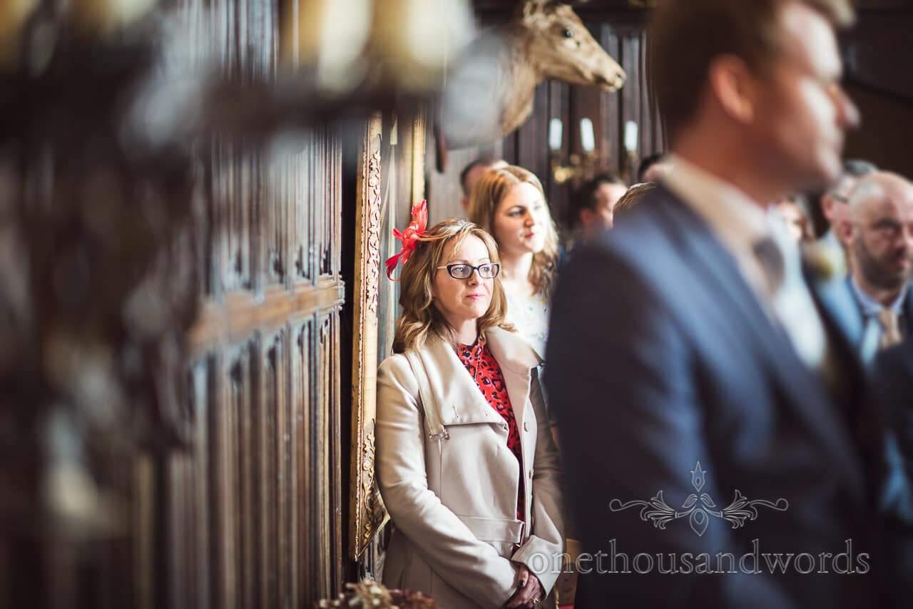 Wedding Guest on historic painting Watches Athelhampton House Wedding ceremony