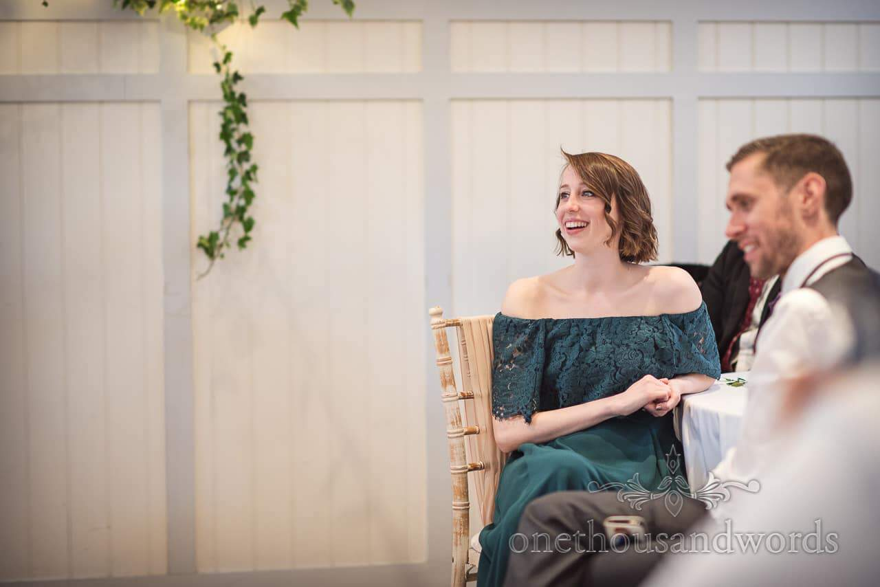 Wedding Guest in Laced detail green dress Laughing at wedding Speeches Documentary Photograph by one thousand words