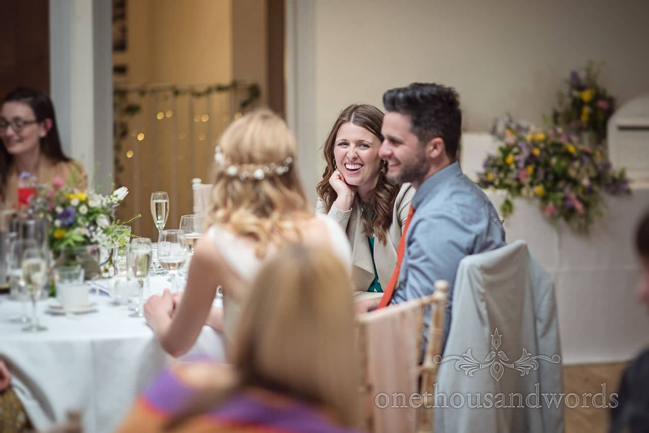 Wedding Guest Laughing During Wedding Speeches at Kings Arms Hotel Christchurch