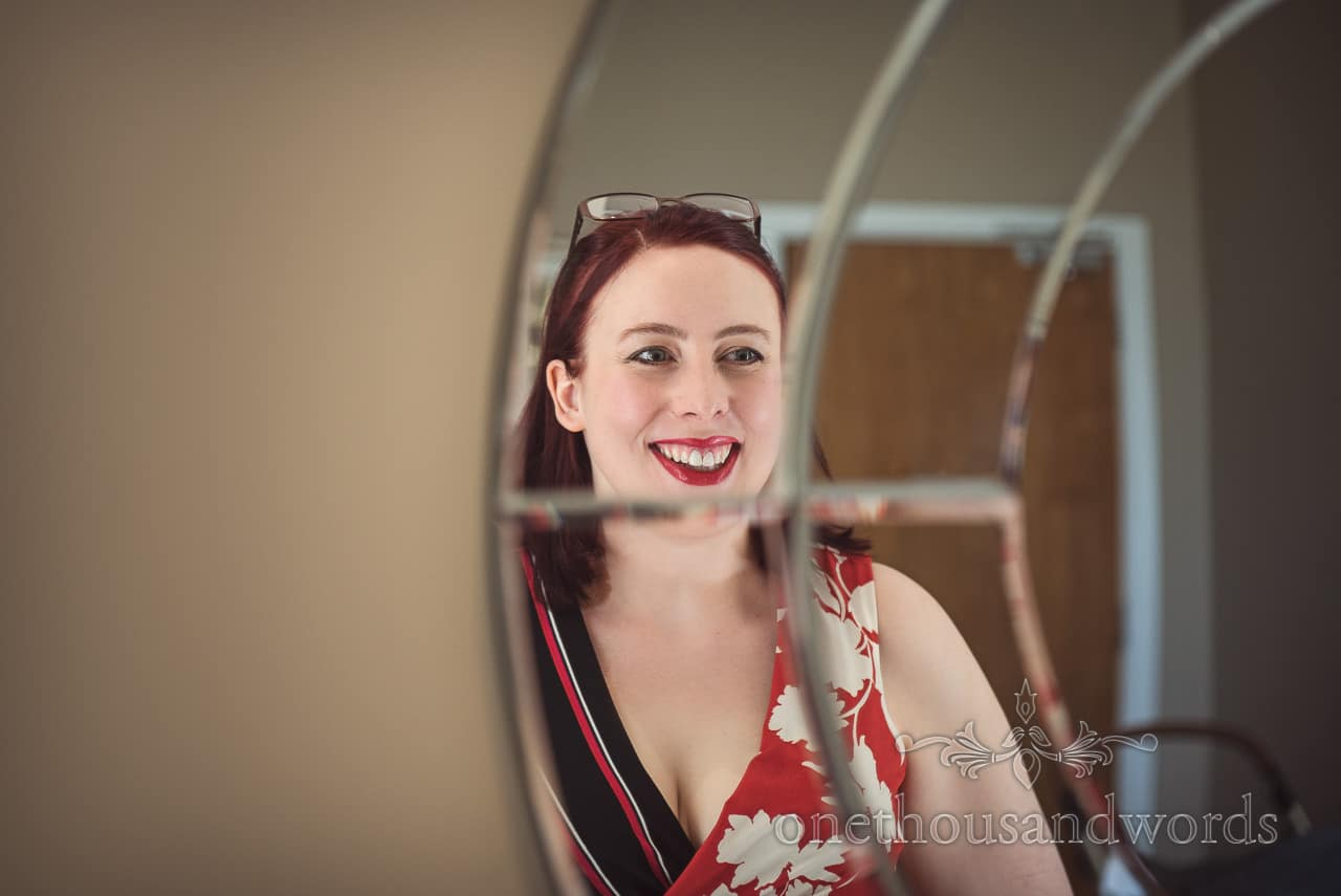 Wedding Guest Makeup in Circular Mirror on Bridal Morning Documentary Photograph by one thousand words wedding photography