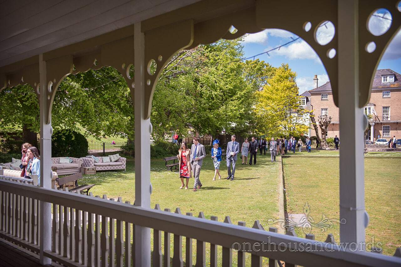 Documentary Photograph of Wedding Guests Arrive at Kings Arms Pavilion Wedding Venue in Christchurch Dorset