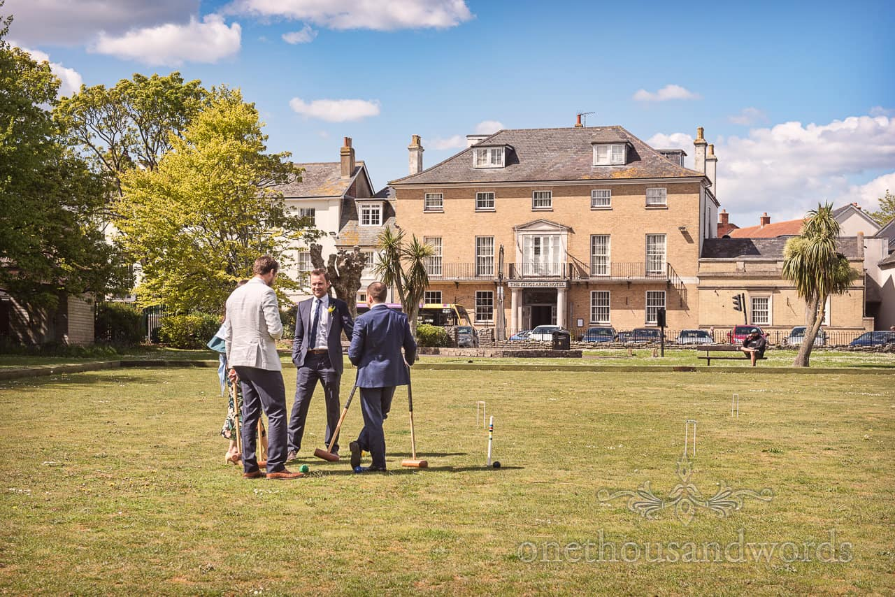 Wedding Guests Play Croquet During Drinks Reception At Kings Arms Christchurch Photograph by one thousand words