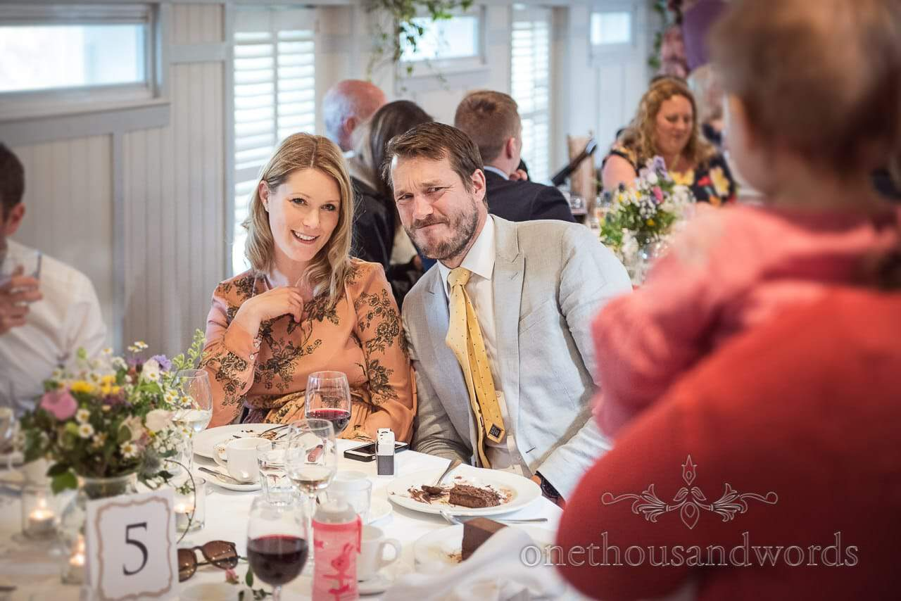 Documentary Photograph of Wedding Guests Pulling Funny Faces at Toddler at Kings Arms Hotel Wedding Breakfast