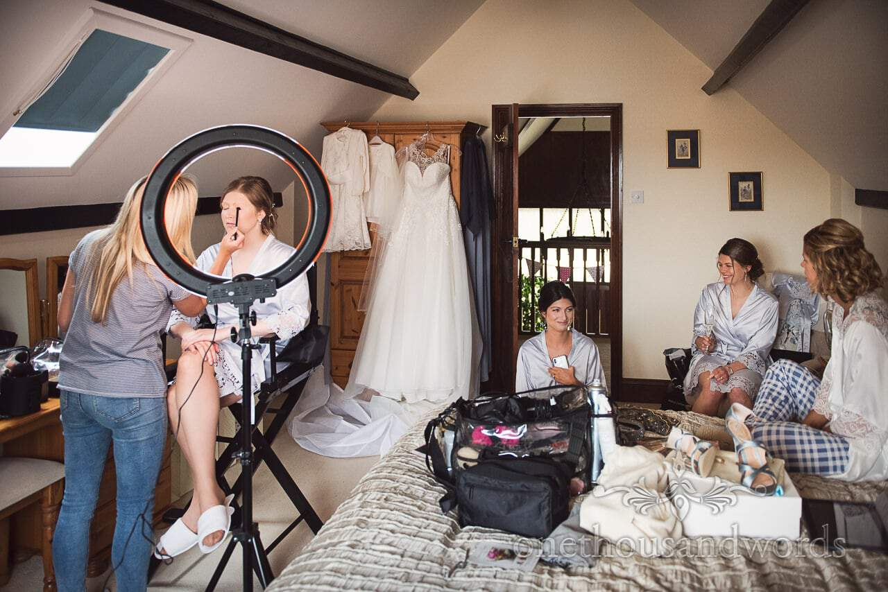 Wedding Makeup is Styled under Circle Light during Bridal Morning Preparations