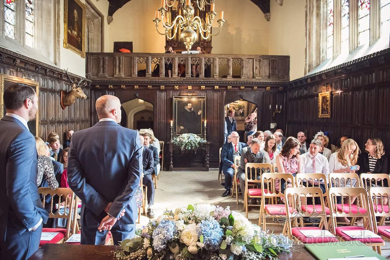 Wedding party await bride at Athelhampton House grand hall