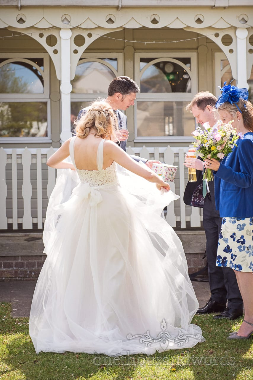 Brides White Wedding Dress Fluffed in Sunshine at Kings Arms Pavilion Spring Garden Wedding Reception Photograph