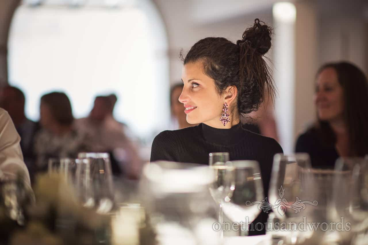 Beautiful Dark Haired Wedding Guest smiling at weddign breakfast table Portrait Photograph