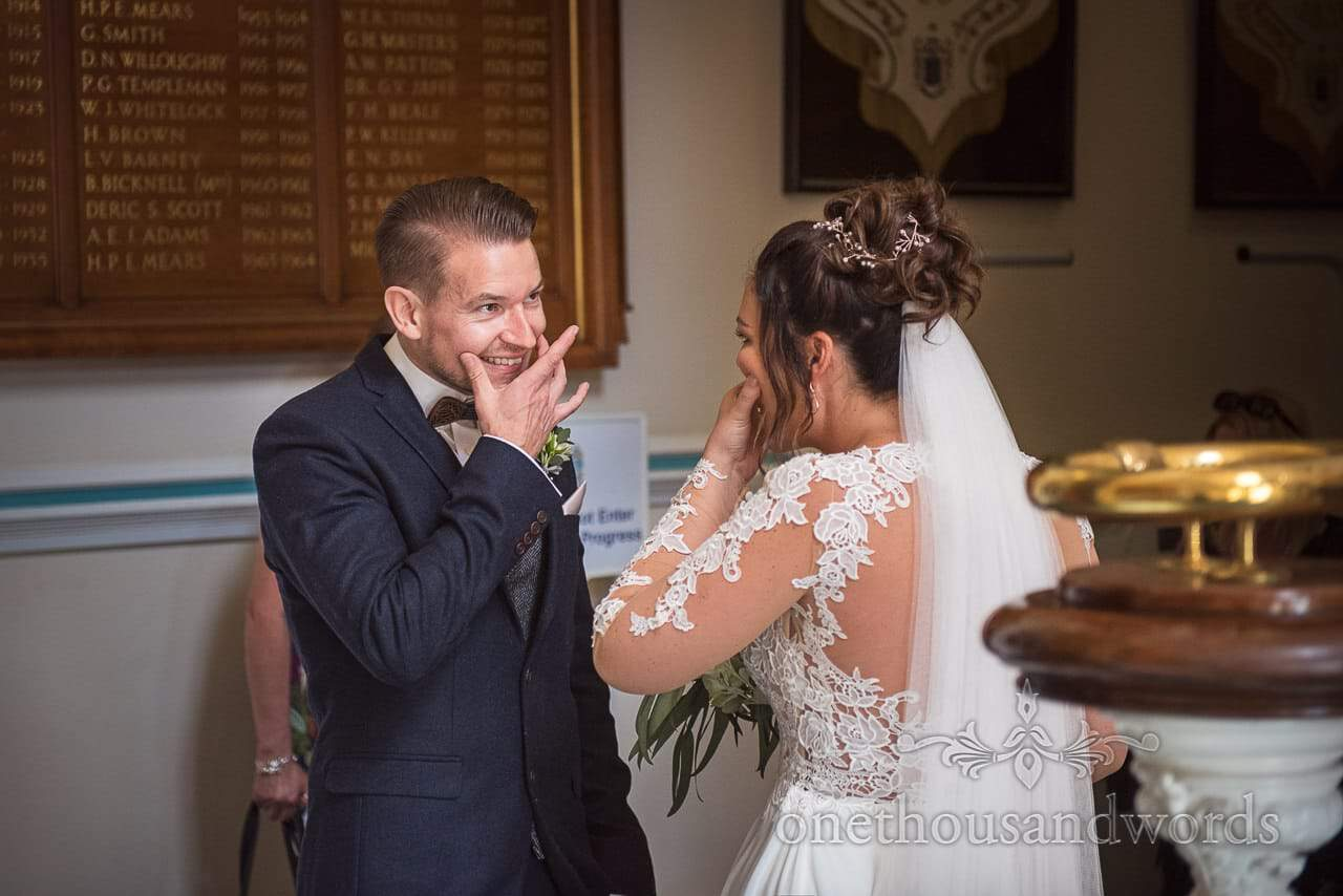 Bride and Groom Share Aching Smile Moment at Bournemouth Town Hall Wedding Photograph by one thousand words photographers