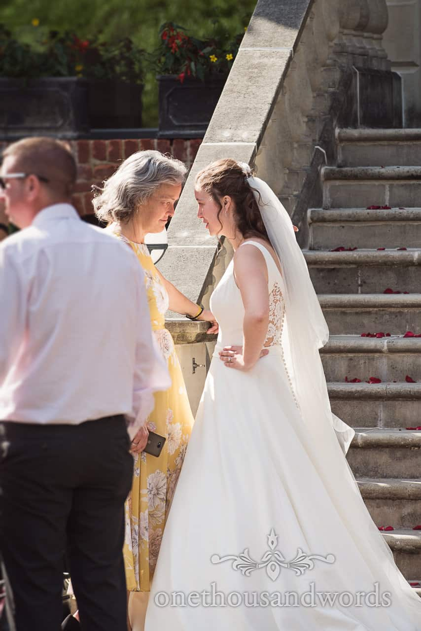 Bride and Mother of bride have a Head To Head moment during wedding drinks reception on Italian Villa stone Steps