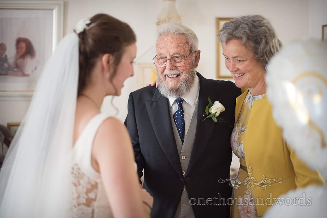 Bride's Grandfather has emotional First Look at bride in wedding dress Photograph on Wedding Morning in Poole, Dorset