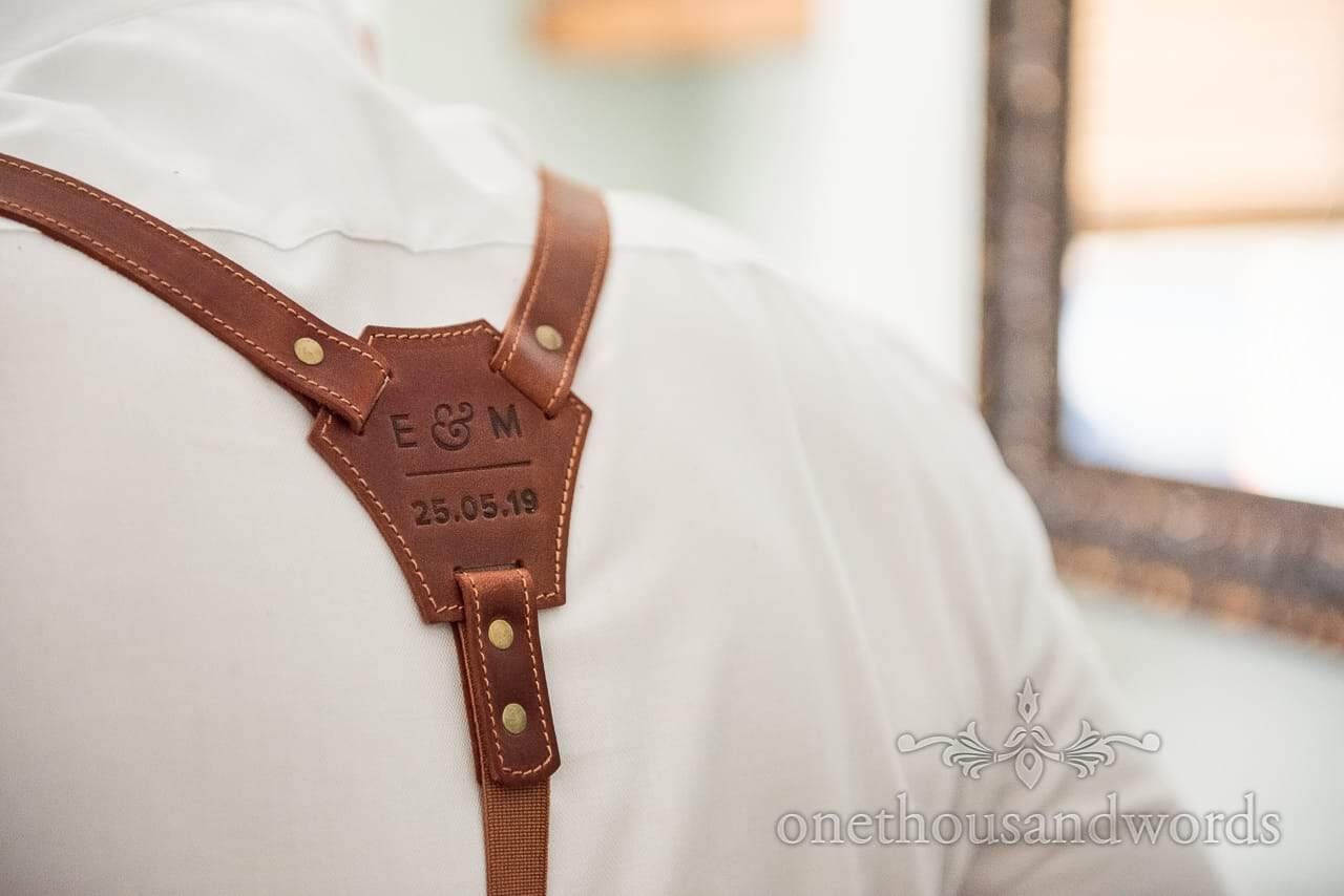 Brown Leather Embossed Braces with wedding date and bride and groom initials wedding morning preparation Photograph