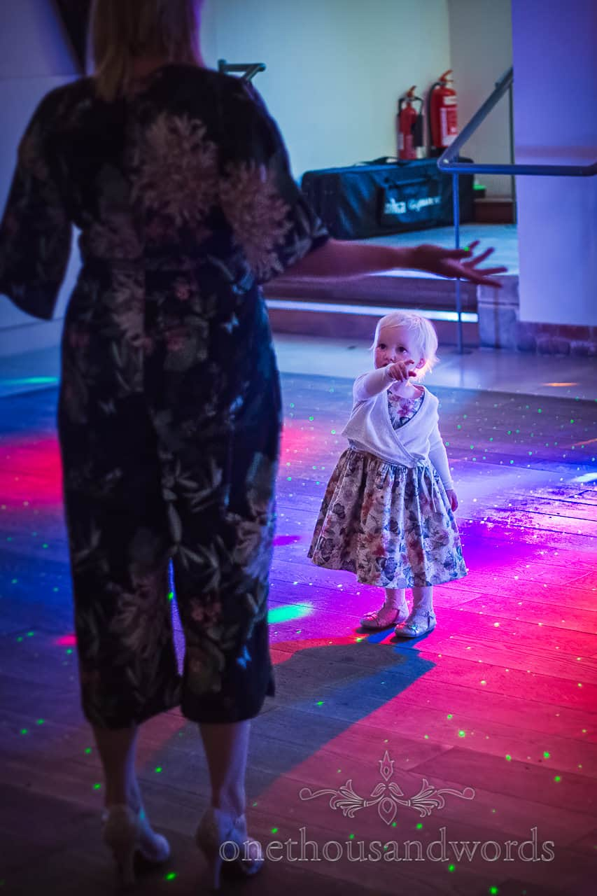 Child Wedding Guest is first on the Dance floor at Wedding evening Disco