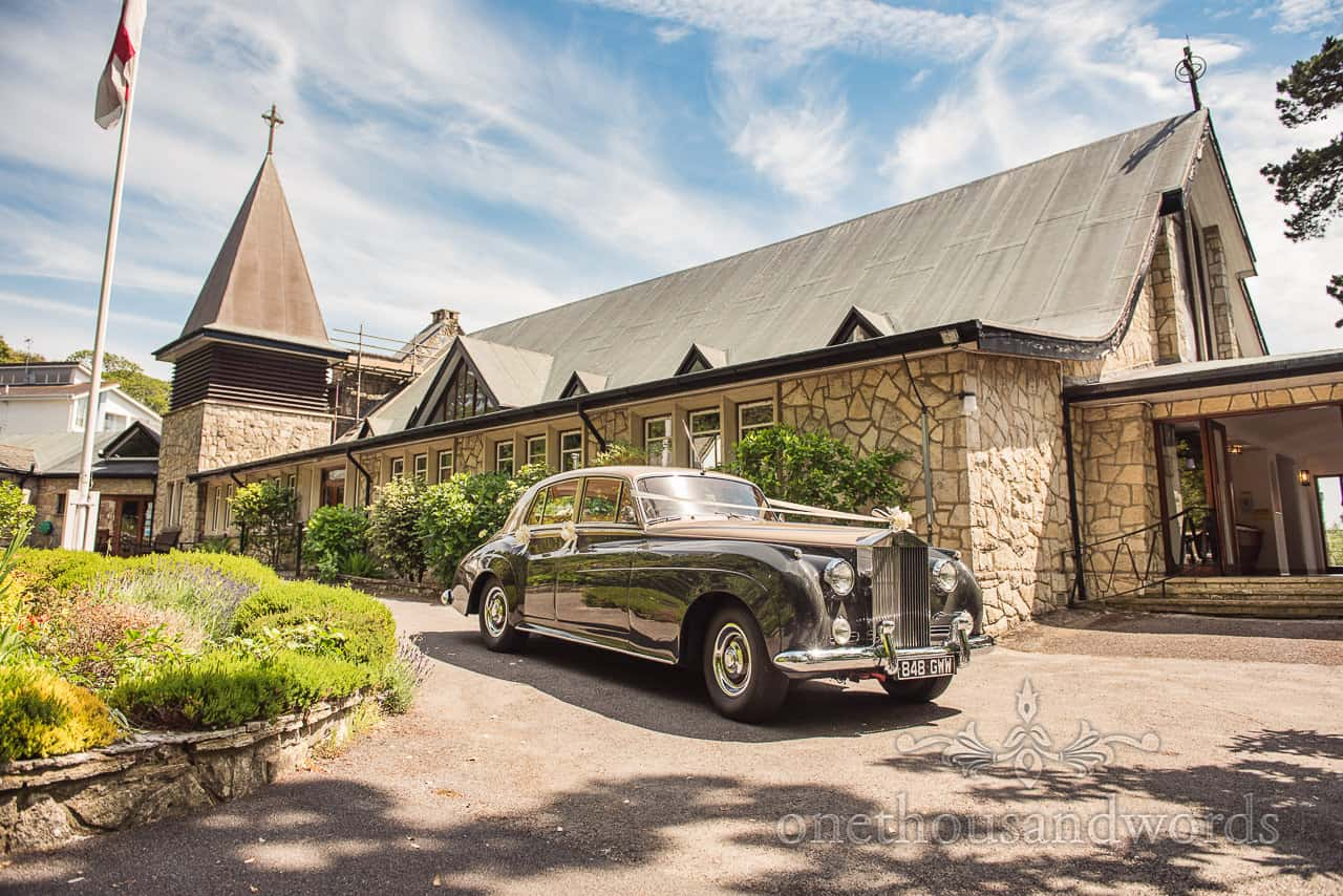 Classic Green and Gold Wedding Car Outside Our Lady of the Transfiguration Sandbanks Poole Church Wedding Venue