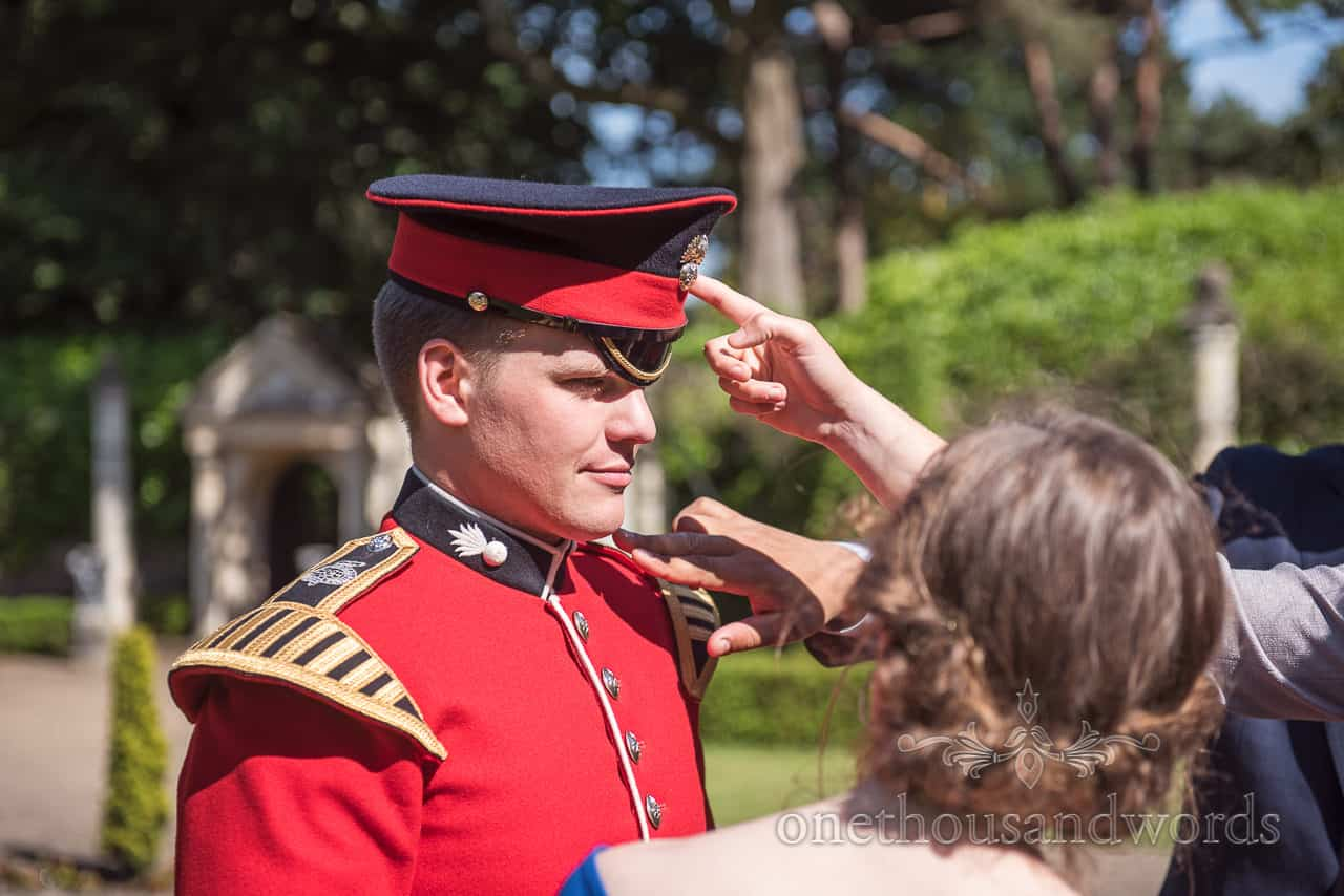 Coldstream Guard Military Groom in red Uniform has his Hat and uniform Poked by Wedding Guests at drinks reception