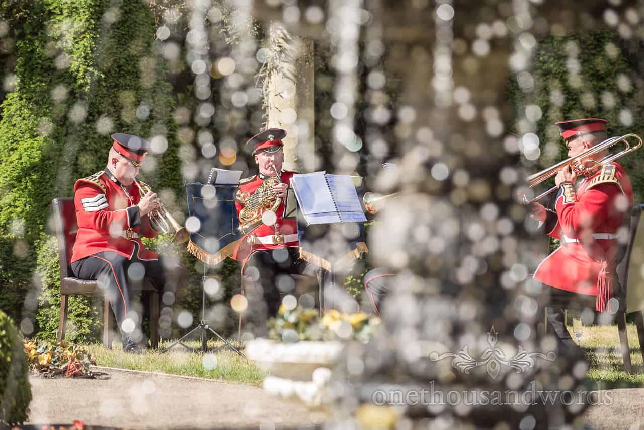 Photograph of Coldstream Guard Wedding Band Playing at Italian Villa wedding venue through Fountain Water Drops
