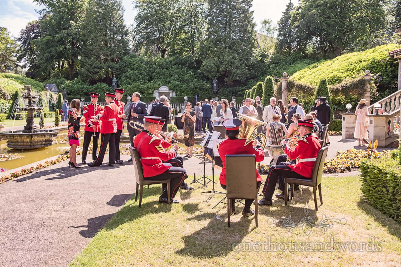 Coldstream Guards Band in red uniforms Play Italian Villa Wedding Poole Reception in summer sunshine