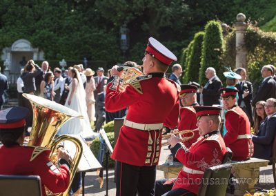 Coldstream Guards in Red military Uniform play at italian Villa wedding venue drinks Reception brass Band Music