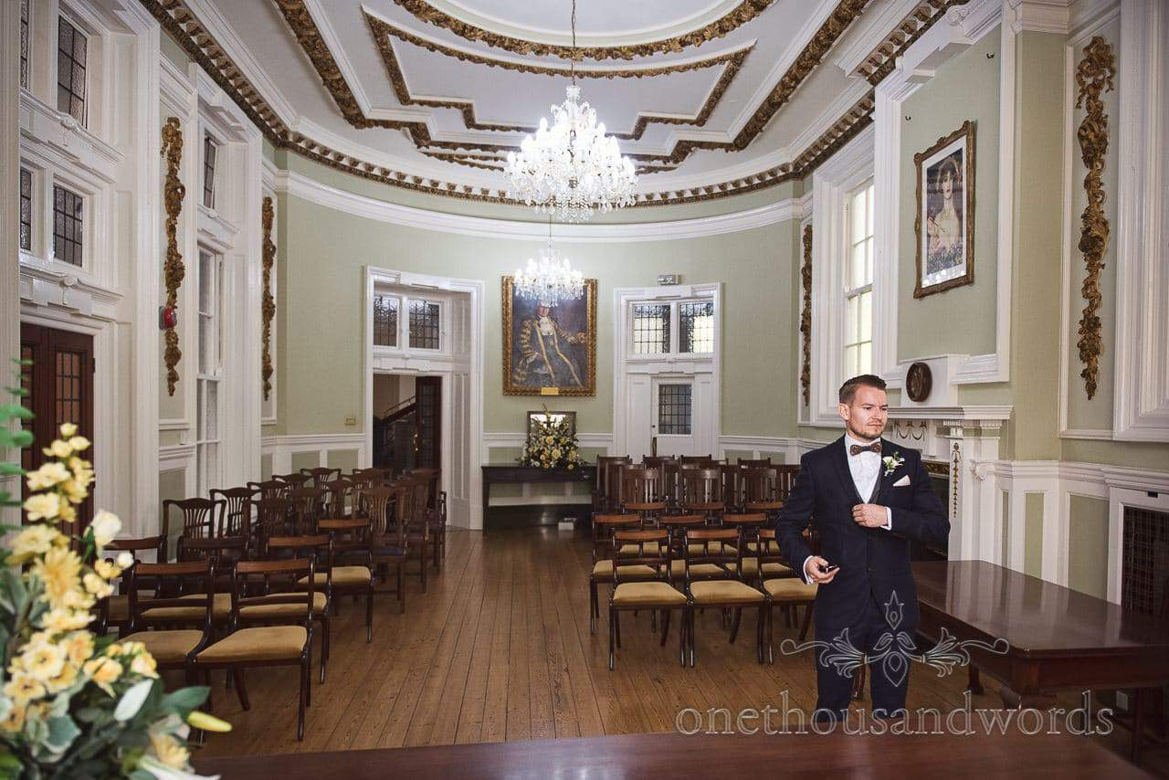 Documentary Photograph of Groom Waiting at Bournemouth Town Hall The Willows Room before wedding ceremony