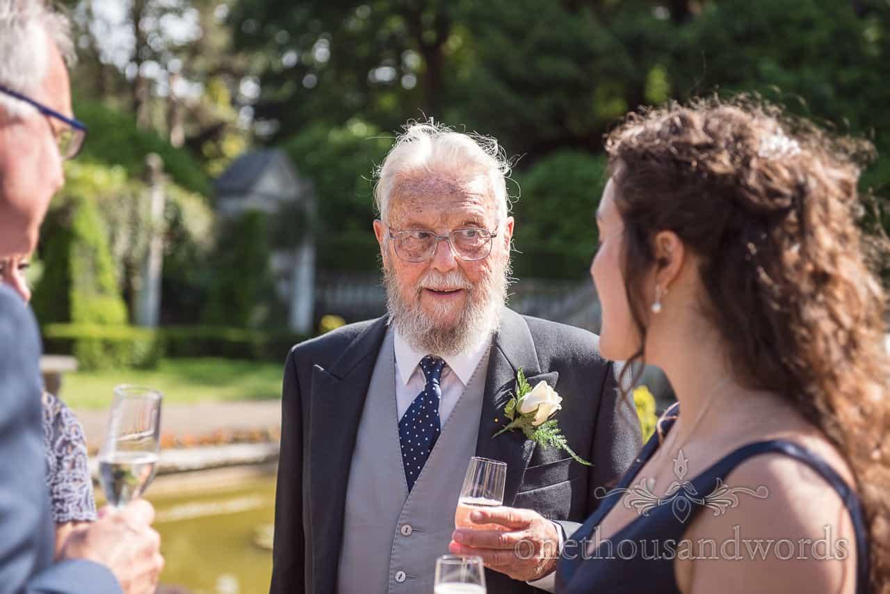 Brides Grandfather in Morning Suit Portrait Photograph at Italian Villa Wedding Drinks Reception in sunshine
