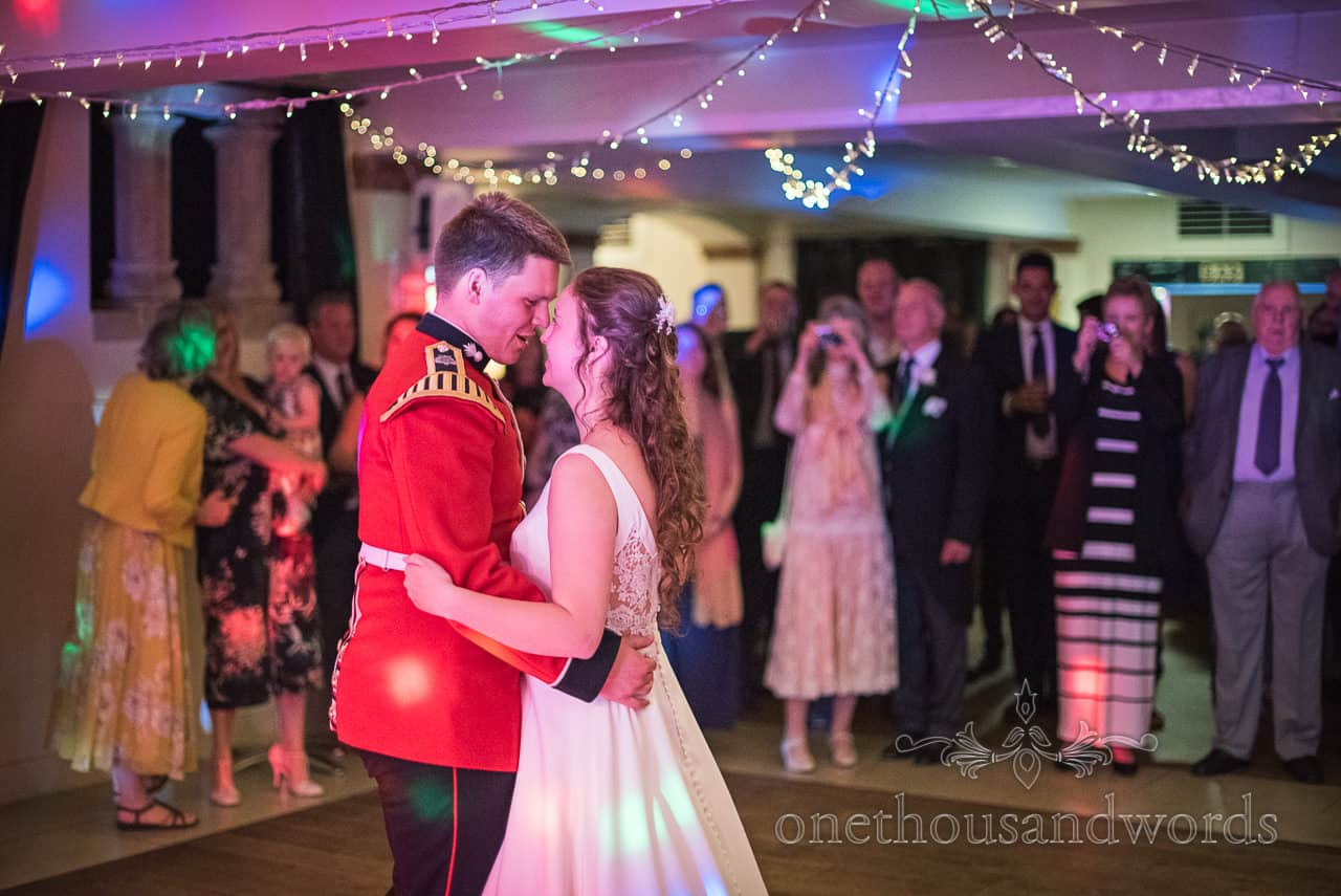 First Dance Photograph military groom and bride with wedding guests and disco lighting at Italian Villa Poole Wedding