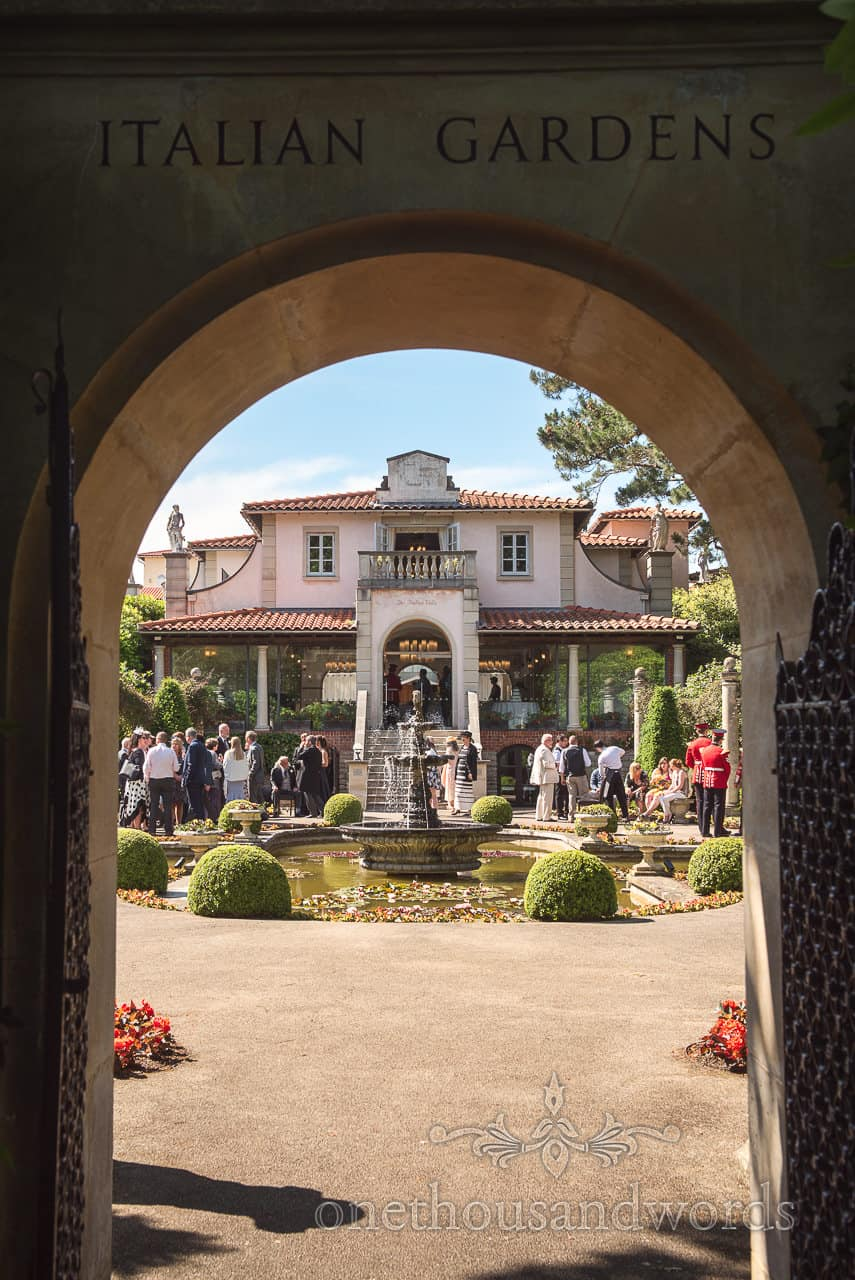 Italian Villa Poole Wedding Venue Photograph through stone Archway to Italian gardens with water fountain and flowers