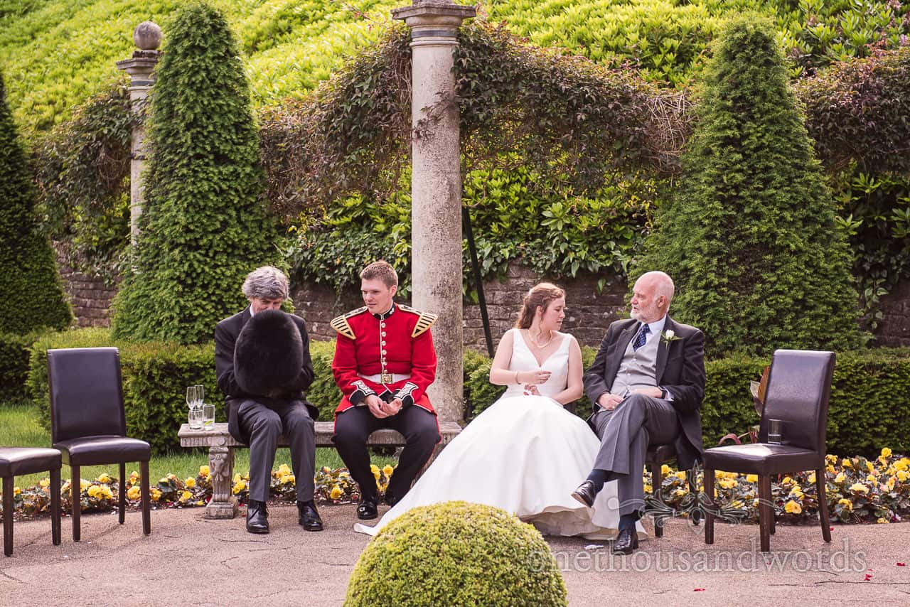 Bride and military Groom with Father and guest Waiting for Wedding Breakfast in Italian gardens at Italian Villa wedding venue